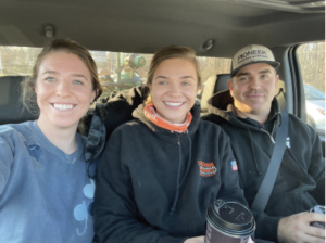 The Remington Mulch team out on a delivery: Caroline Armstrong, center, sister Katie, left; brother Trent, right.